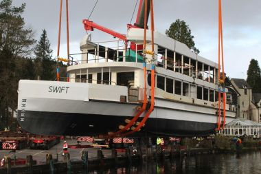 The shell of MV Swift being lowered into Lake Windermere for the 1st time. by crane