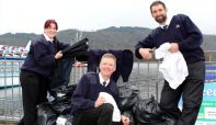 3 Windermere Lake Cruises staff give out clothing