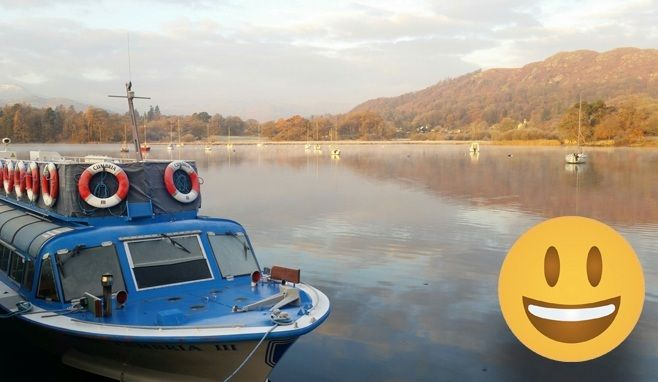 Smiley face emoji with a boat in the background at Ambleside
