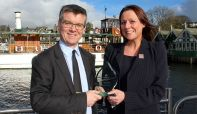 Nigel Wilkinson (Managing Director) and Jen Cormack (Sales & Marketing Director) with the award at Bowness Pier