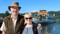 A couple about to board a steamer from Bowness Pier as part of the Silver Sailor Scheme.