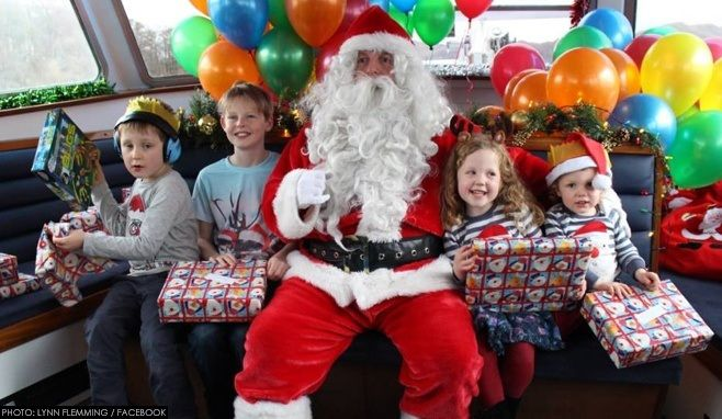 Father Christmas and children on board a previous Santa Cruise from Windermere Lake Cruises