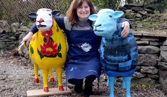 Colourful sheep sculptures set sail on Windermere