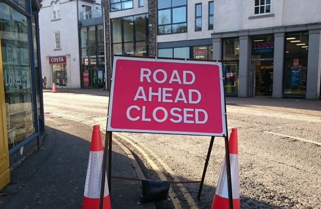 A sign in Bowness village indicating that the road ahead is closed.