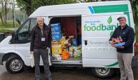 James Ventham from Windermere Lake Cruises helps unload the donations to the Morecambe Bay Foodbank