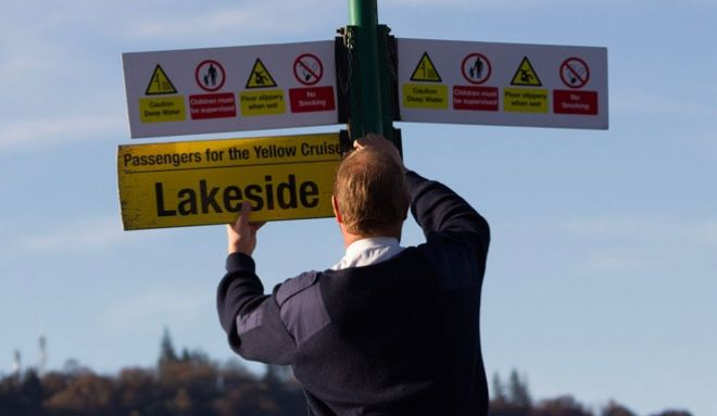 A man putting the sign up for Lakeside