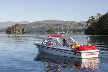 A luxury motor boat heading out to explore Windermere