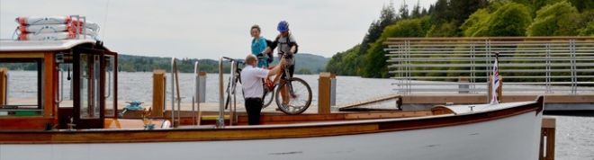 A couple getting on the bike boat at bark barn