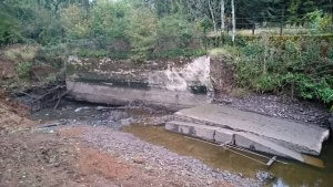 Condition of collapsed retaining wall following river diversion