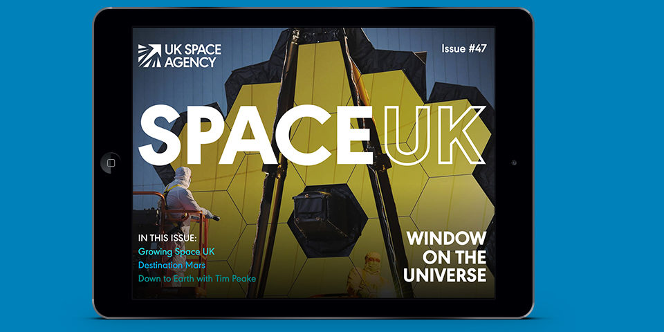 The cover of SpaceUK magazine is shown on the screen of an iPad, against a blue background.