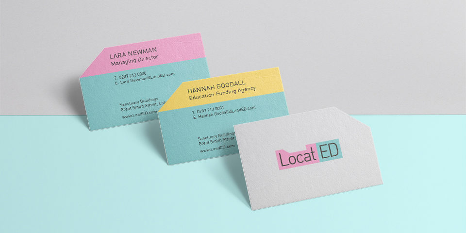 LocatED business cards in turquoise, pink, grey and yellow. They have a chopped-off corner to match the LocatED logo, which appears on the front.