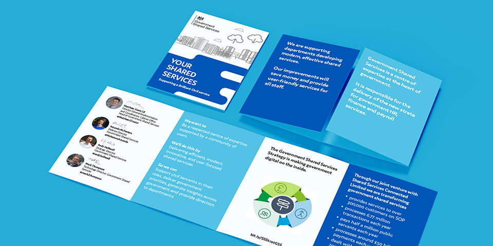 The Future Shared Services leaflet unfolded on a blue background. The main colours in the leaflet are light and dark blue. The text is too small to read.