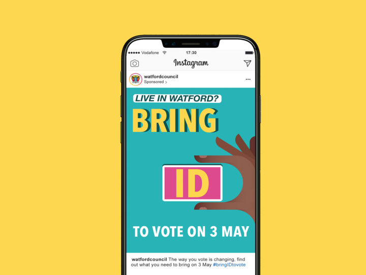 A mockup of a smartphone with Voter ID graphic. It reads 'Live in Watford? Bring ID to vote on 3 May'.