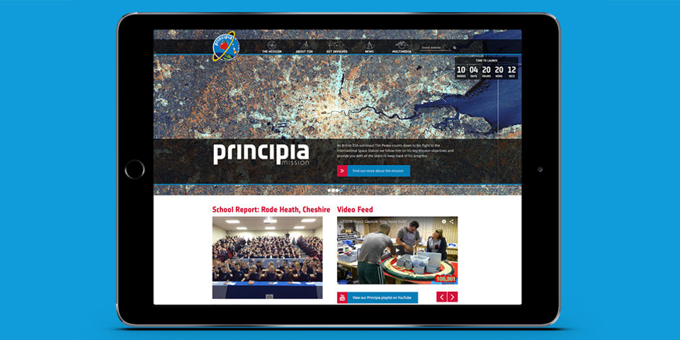 The Principia website is shown on an iPad screen. At the top there is a banner image in the brand style depicting a satellite map.