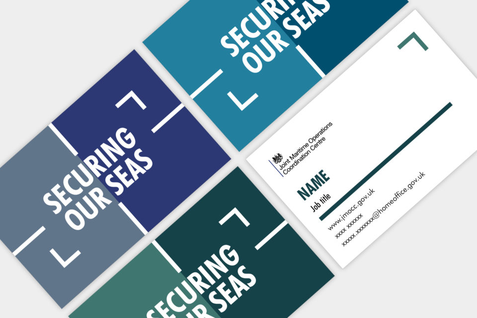 Mock ups of business cards showing the maritime branding, with the wording 'securing our seas'