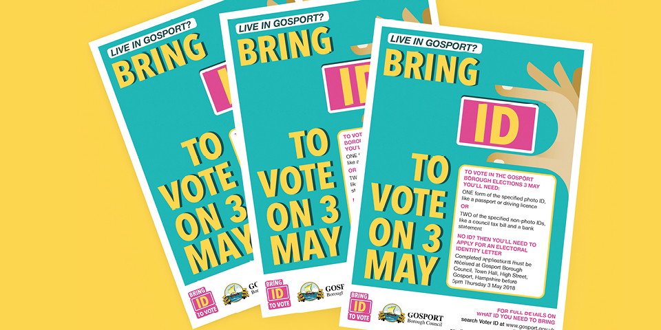 Three leaflets sit on top of each other. The top leaflet says: Live in Gosport? Bring ID to vote on 3rd May.