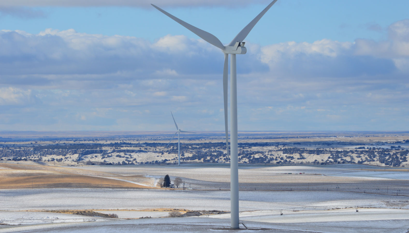 Wind turbine in a snowy field