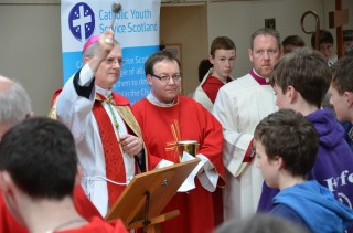 Archbisop Leo Cushley blesses the Palms before the procession to the church