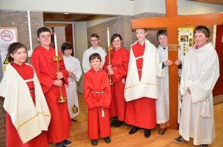 Altar servers prepare to lead Scotland's young Catholics, their priest and bishops to celebrate Mass