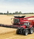 Optum_300_CVX_with_unloading_trailer_and_Axial-Flow_01