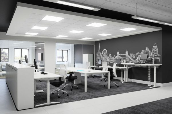 A modern office design with a London decal on the wall. Beautiful high white furniture that contrasts with a stark grey.