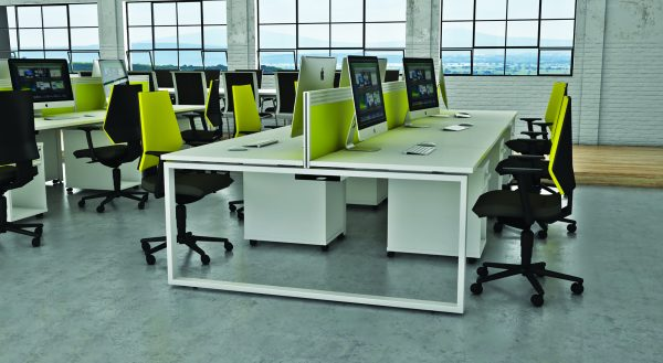 In this office refurb we've included large work desks with lime green partitioning. The modern office furniture works well set against this old factory conversion.