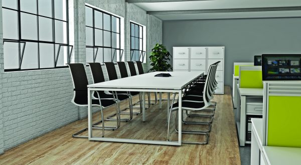A clean edged, modern meeting room table and black meeting room chairs in a gentrified office block.