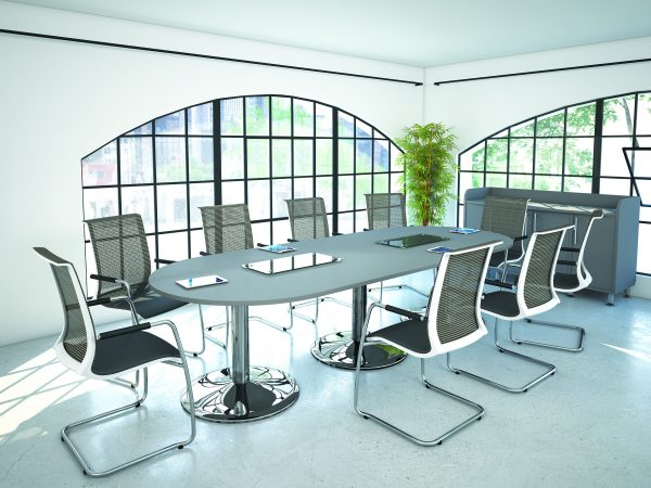 Mesh black and white chairs, grey meeting room table with chrome feet. Arched window bringing in plenty of natural light.