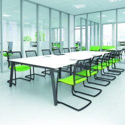 Modern office design with glass partitions. This meeting room contains a large, white meeting room table and line green/black mesh chairs.