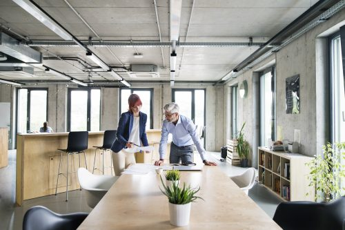 Man And Woman Planning In Office