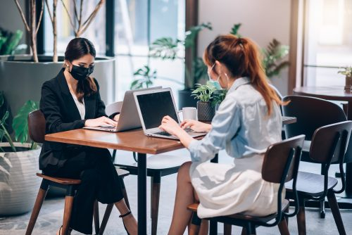Socially Distanced Female Office Workers