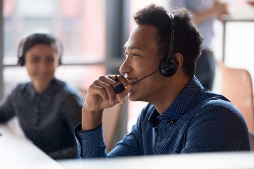 man-speaking-on-phone-in-office