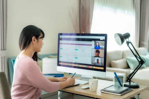 Woman working from home on video call