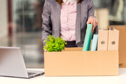 Young,Happy,Business,Woman,With,Boxes,For,Moving,Into,A