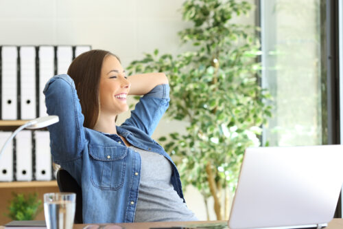 happy-woman-at-office-desk