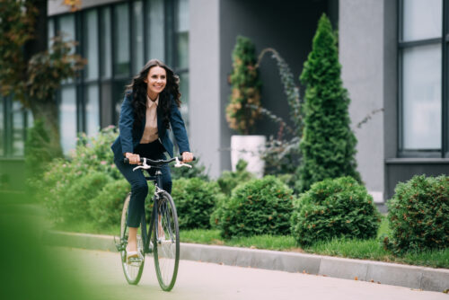 Young,Happy,Businesswoman,Riding,Bicycle