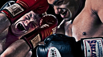 Close-up view from below of two boxers in action