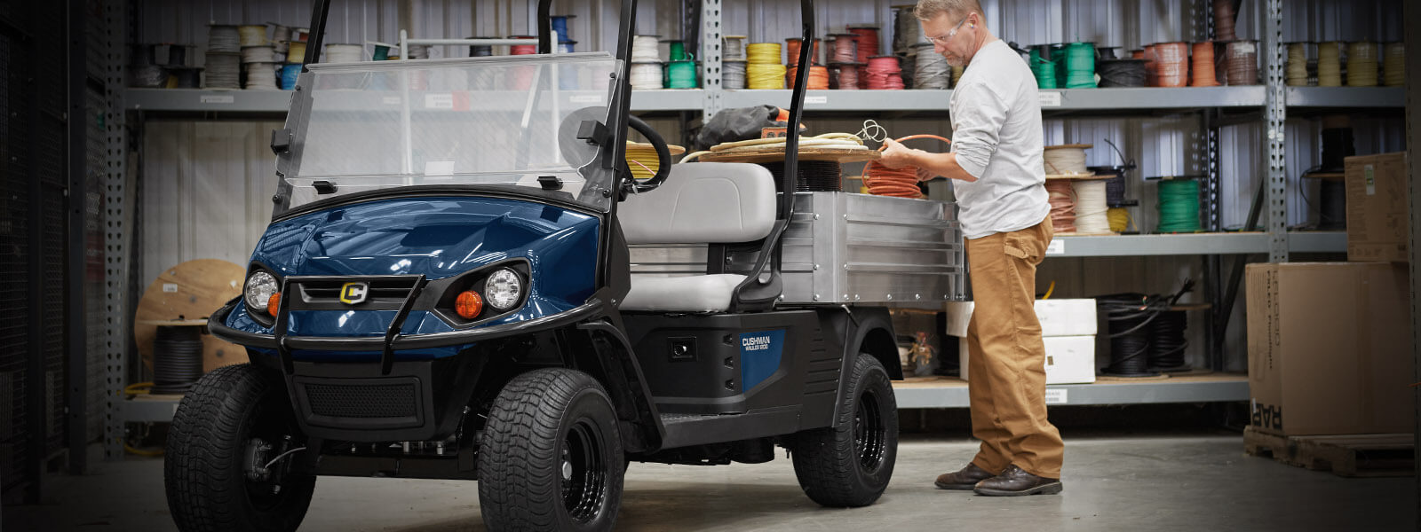 Cushman Hauler Pro in blue at workshop