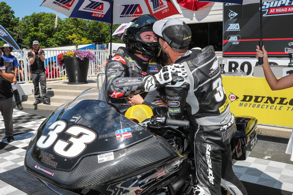 Brothers and Harley-Davidson Screamin' Eagle factory teammates Kyle (right) and Travis Wyman celebrate their 1-2 finish in the King of the Baggers at Road America. Photo Credit: Brian J. Nelson