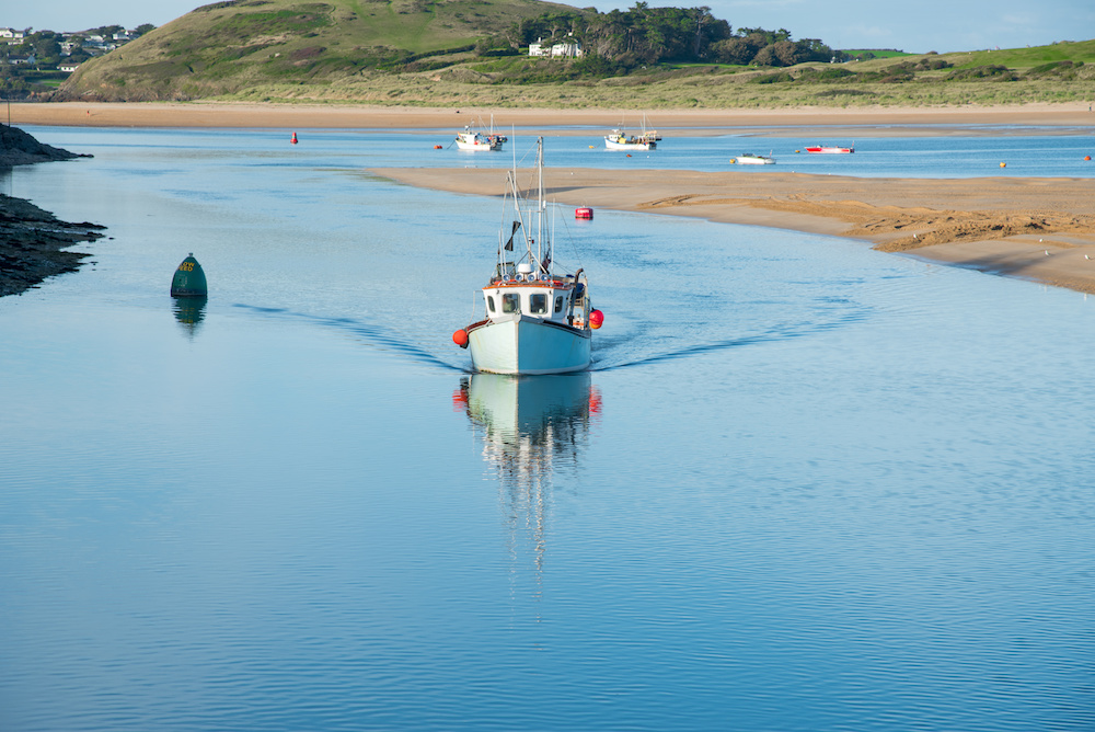 Fishing boat arrives in the port of Padstow at the Camel estuary in north Cornwall