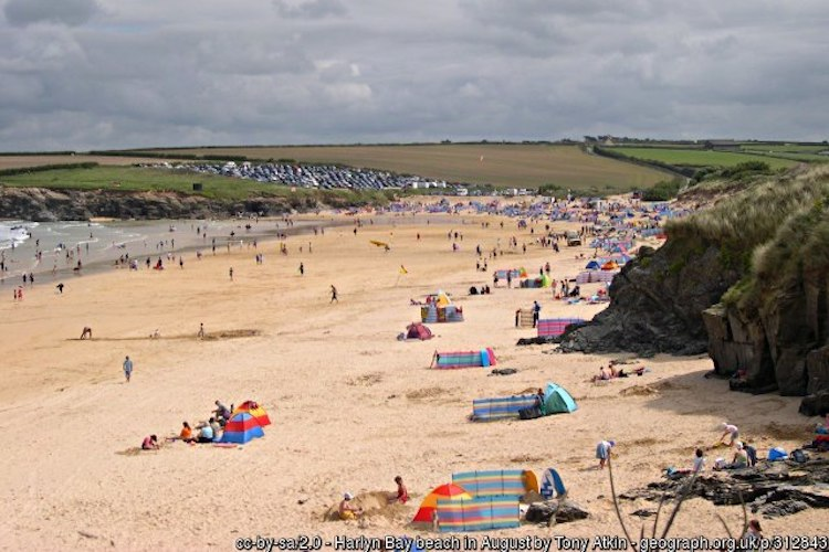Holidaymakers on the beach at Harlyn Bay in North Cornwall