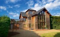 An upside-down cedar clad house