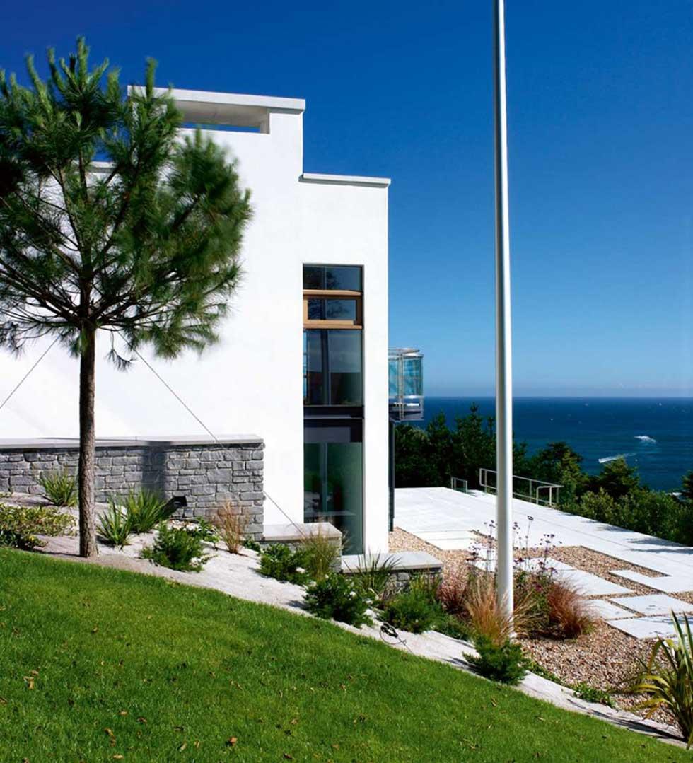 The exterior of Tony Gibbon's coastal home