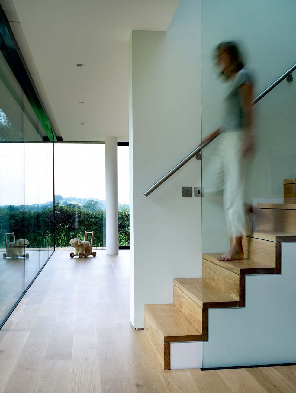 A modern staircase with glass panelling