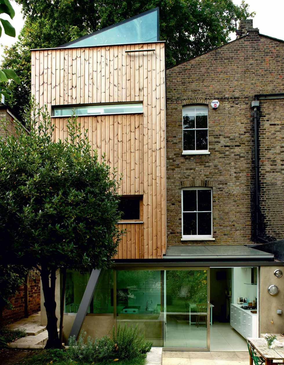 A narrow timber-clad extension with a sloping glass roof