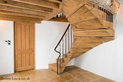 Rustic Oak Staircase with forged handrail