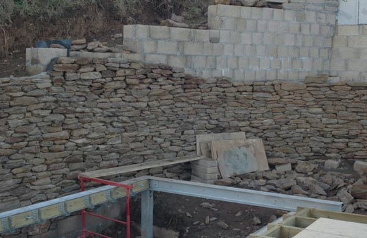 Laying the stone wall