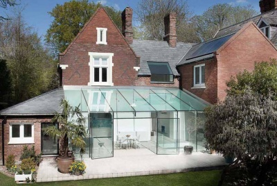 Frameless glass extension to a Victorian house