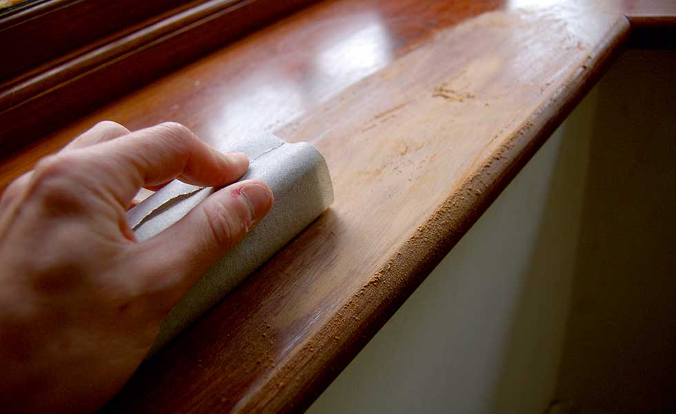 sanding down the window sill