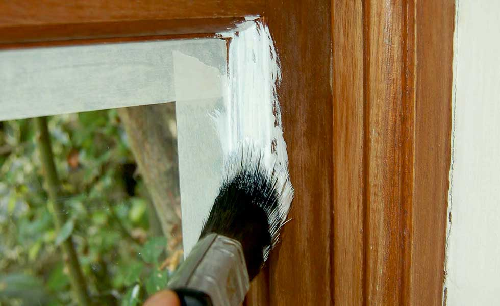 undercoat paint with paint brush round window